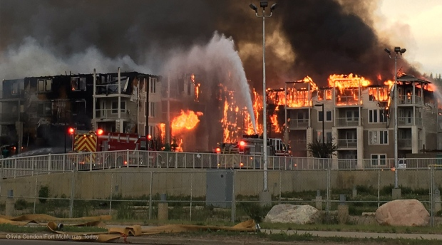 Apartment complex fire brings smoke back to downtown Fort McMurray by Ahmed Fattouh in Edmonton AB