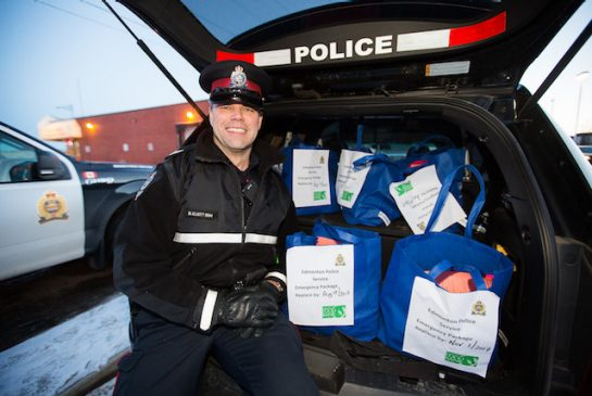 Police partner with Food Bank to get food in hands of city's most vulnerable by Ahmed Fattouh in Edmonton AB